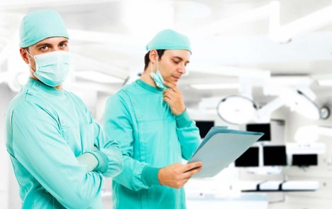 Portrait of two surgeons in a operating theatre